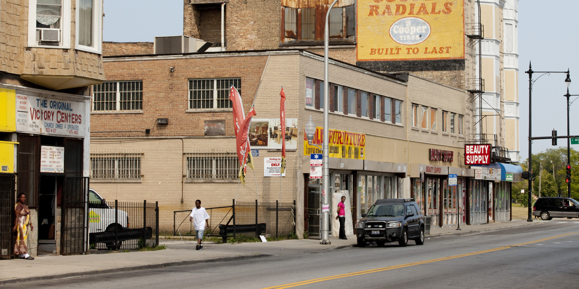 CHICAGO, IL - AUGUST 19: People walk through a commercial area in the Englewood neighborhood, on August 19, 2013 in Chicago, Illinois. Englewood is a depressed neighborhood of Chicago with a high crime rate that has been hit even harder by the sluggish economy. Some people are moving out to the suburbs to escape the violence. (Photo by Melanie Stetson Freeman/The Christian Science Monitor via Getty Images)